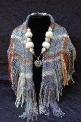 The scarf is handwoven from handspun alpaca yarn.