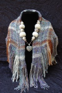 The scarf is handwoven from handspun alpaca yarn.