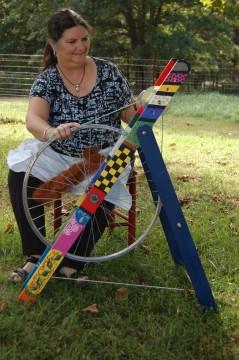 Spinning alpaca fiber on a handmade wheel.